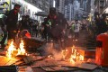 Anti-government protesters set fires in Wan Chai on October 6 following a rally in defiance of the anti-mask law issued by the government the day before. Photo: Sam Tsang