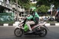 A GrabFood driver delivers an order in Jakarta, Indonesia. Photo: Bloomberg