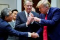 US President Donald Trump shakes hands with Japan's ambassador to the US Shinsuke Sugiyama in front of US Trade Representative Robert Lighthizer. Photo: Reuters
