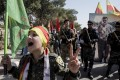 Fighters of the Syrian Democratic Forces march during a demonstration against possible Turkish military operations. Photo: AP