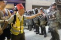 Uncle Chan faces riot police in Prince Edward during a recent protest. Photo: Edmond So