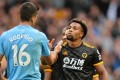 Wolverhampton Wanderers forward Adama Traore (right) shakes hands with Rodrigo, of Manchester City, after their English Premier League win at the Etihad Stadium. Photo: EPA