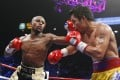 Floyd Mayweather Jnr throws a left against Manny Pacquiao during their fight in Las Vegas in 2015 which Mayweather won by unanimous decision. Photo: AP