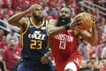 In this April 17, 2019, file photo, Houston Rockets guard James Harden (right) drives against Utah Jazz forward Royce O'Neale during a first-round NBA basketball playoff series in Houston. Photo: AP