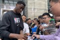 The Brooklyn Nets' Caris LeVert signs autographs for fans outside the Shanghri-La hotel in Shanghai. Photo: Thomas Yau
