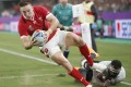 Wales' Josh Adams scores his second try during the first half of the Rugby World Cup pool D match against Fiji in Oita. Photo: Kyodo