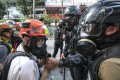 Reporters can have their gas masks removed by police under the new law. Photo: Felix Wong