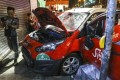 Anti-government protesters damage a taxi and beat up the driver in Sham Shui Po. Photo: K.Y. Cheng