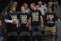 """Activists wear """"Free Hong Kong"""" T-shirts before an NBA exhibition game between the Washington Wizards and the Guangzhou Loong-Lions on October 9 in Washington. Photo: AP"""