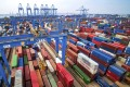 Containers are piled up at a port in Qingdao in east China's Shandong province. Photo: Chinatopix via Associated Press