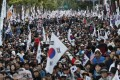 Demonstrators march near Seoul's presidential Blue House on Wednesday in protest at the appointment of Cho Kuk. Photo: AP