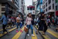 About one-fifth of the Hongkongers surveyed showed no confidence in Beijing and the city's overcrowded living conditions. Photo: AFP