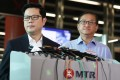 Sammy Wong (left), the MTR Corp's chief of operations, and Alan Cheng, the general manager for special duties, on Friday at Tseung Kwan O MTR station. Photo: Xiaomei Chen
