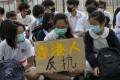 Students wear a mask outside Shau Kei Wan government secondary school in Sham Kei Wan. Photo: SCMP