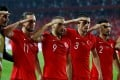 Turkey's Cenk Tosun celebrates scoring their first goal in the match against Albania. Photo: REUTERS