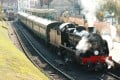 A classic train pulls out of Swanage station