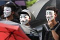 Protesters march with their masks on. Photo: Xiaomei Chen