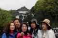 Chinese tourists take photos in front of the Imperial Palace in Tokyo, Japan. Photo: Reuters