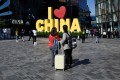 People visit a shopping area in Beijing on October 14. China's days of double-digit GDP growth are probably over, and it must contain its debt risks to manage this trend of slowing growth. Photo: AFP