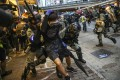 Scuffles break out between riot police and anti-government protesters on October 5. Photo: Winson Wong