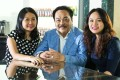 Tan Hiep Phat Beverage Group (THP) founder Tran Qui Thanh and daughters Phuong Uyen Tran (L) and Tran Ngoc Bich at their office. Photo: Handout