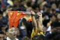 A child holds up two Chinese national flags as she watches a pre-season NBA basketball game between the Brooklyn Nets and Los Angeles Lakers at the Mercedes Benz Arena in Shanghai on October 10. Photo: AP