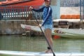 Stand-up paddleboarding offers a low-impact postnatal recovery workout. Photo: Ariel Conant