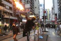 Protesters throw petrol bombs at police during recent anti-government protests against the government's new anti-mask law. Photo: Sam Tsang