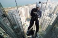 """The Securities and Futures Commission's Chief Executive Officer Ashley Alder rapelling from the 68th floor of the One Island East building in Quarry Bay on 9 December 2017 to raise funds for the Outward Bound Hong Kong (OBHK) Vertical 1000 """"The Adventure of A Life Time"""" event. Photo: Winson Wong"""