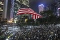 Anti-government protesters wave the US flag during a protest at Chater Garden in Central. Photo: Felix Wong