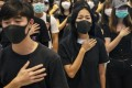 """Hong Kong protesters in their """"uniform"""" of black T-shirts at a shopping mall in Yuen Long district. Chinese customs authorities have banned the shipping of black clothing to Hong Kong. Photo: EPA-EFE"""