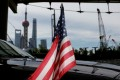 A US flag on an embassy car outside a hotel in Shanghai. The trade war will drag on private equity deals in the next 12 to 18 months, the survey found. Photo: Reuters