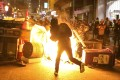 Protesters throw petrol bombs and set objects on fire during a scuffle with police on September 29. Photo: K.Y. Cheng