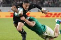New Zealand's Aaron Smith is tackled by Ireland's Iain Henderson during the Rugby World Cup quarter-final in Tokyo Stadium. Photo: EPA