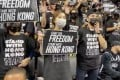 Hong Kong pro-democracy protesters at the NBA game between the Brooklyn Nets and Toronto Raptors in New York City. Photo: Reuters