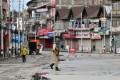 A soldier patrols a deserted street in Srinagar, Kashmir. Photo: AFP