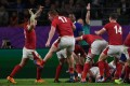 Wales players react after scoring a try against France. Photo: AFP