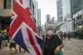 An elderly woman with a British flag at a protest in Hong Kong on June 12. Brexit has paralysed government for three years. Will it take us in Hong Kong as long to find resolution? Photo: Antony Dickson