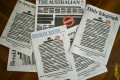 National and regional titles across Australia hit news-stands on Monday with most of their front-page news stories blacked out. Photo: EPA