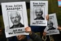Demonstrators outside the Westminster Magistrate's Court in London hold posters calling for WikiLeaks founder Julian Assange to be freed and not extradited to the US. Photo: AFP