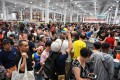 Customers make a beeline at Costco's store opening in Shanghai on August 27, 2019. Photo: AFP