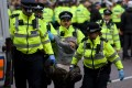 Police arrest a climate activist during the third day of Extinction Rebellion demonstrations in London on October 9. Photo: AFP