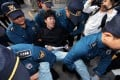 South Korean police officers detain a protester at Habib House in Seoul on Friday. Photo: EPA-EFE