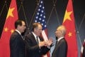 US Trade Representative Robert Lighthizer (centre) gestures as he chats with Chinese Vice-Premier Liu He and Treasury Secretary Steven Mnuchin at the Xijiao Conference Center in Shanghai, as both sides head for negotiations to end a 15-month trade war. Photo: AP