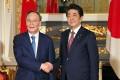 Japan's Prime Minister Shinzo Abe greets Chinese Vice-President Wang Qishan at the Akasaka State Guesthouse in Tokyo. Photo: Jiji Press/ AFP