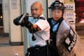 Sergeant Lau Chak-kei became a celebrated figure in mainland China after he raised a shotgun at Hong Kong's anti-government protesters at Kwai Chung in July. Photo: Reuters