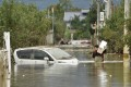 A man in Nagano wades through floodwaters in the aftermath of Typhoon Hagibis. Photo: AFP