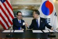 US Secretary of the Treasury Steven Mnuchin shake hands with South Korean Deputy Prime Minister and Finance Minister Hong Nam-ki on October 17. Photo: AP
