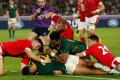 South Africa's centre Damian De Allende (centre) scores a try during the Rugby World Cup semi-final match against Wales. Photo: AFP
