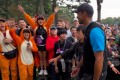 Fans wearing tiger costumes welcome Tiger Woods in Tokyo. Photo: AFP